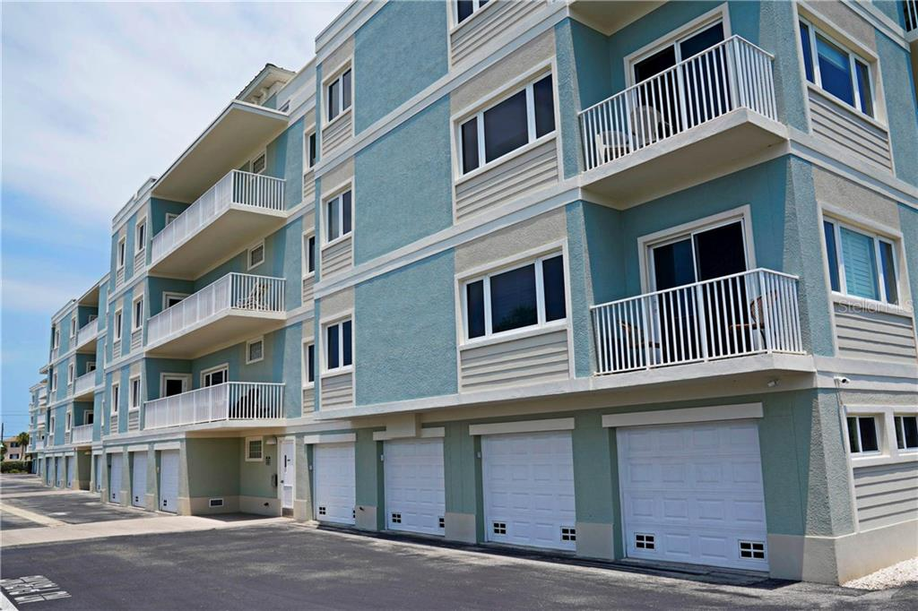 The garage uner the building allows room for two vehicles plus storage space - Condo for sale at 2245 N Beach Rd #304, Englewood, FL 34223 - MLS Number is D6112346