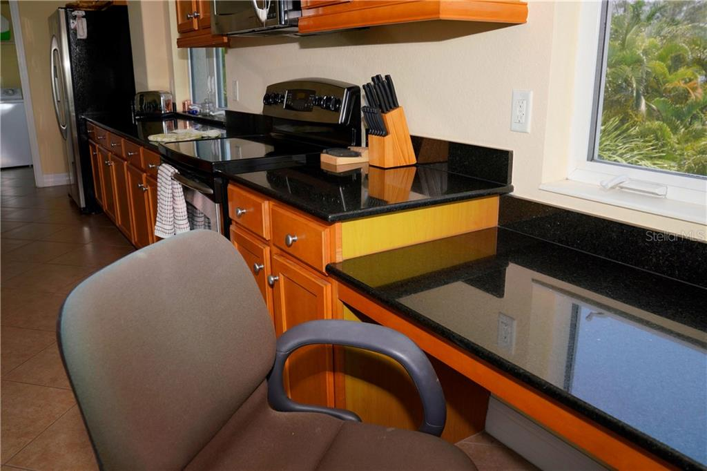 Desk area in kitchen under large window w/view - Condo for sale at 2245 N Beach Rd #304, Englewood, FL 34223 - MLS Number is D6112346