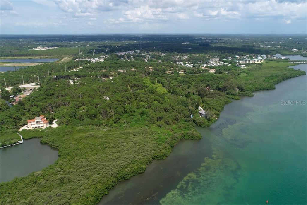 property sits between the 2 homes - Vacant Land for sale at 9427 Downing St, Englewood, FL 34224 - MLS Number is D6112667