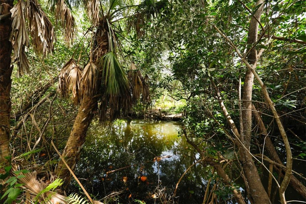 tidal canal on southern border - Vacant Land for sale at 9427 Downing St, Englewood, FL 34224 - MLS Number is D6112667