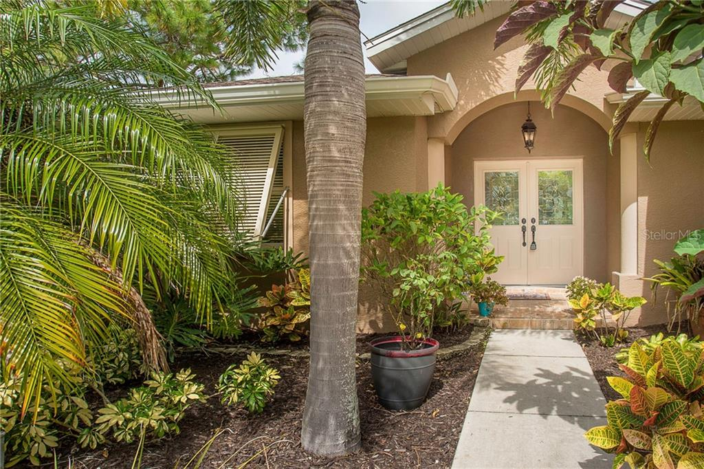 Plantation hurricane shutters and double doors with smart locks welcome you home with ease. - Single Family Home for sale at 185 Apollo Dr, Rotonda West, FL 33947 - MLS Number is D6113690