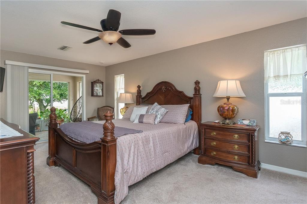 Master bedroom boasts a king size Tommy Bahama style bedroom set - Single Family Home for sale at 185 Apollo Dr, Rotonda West, FL 33947 - MLS Number is D6113690