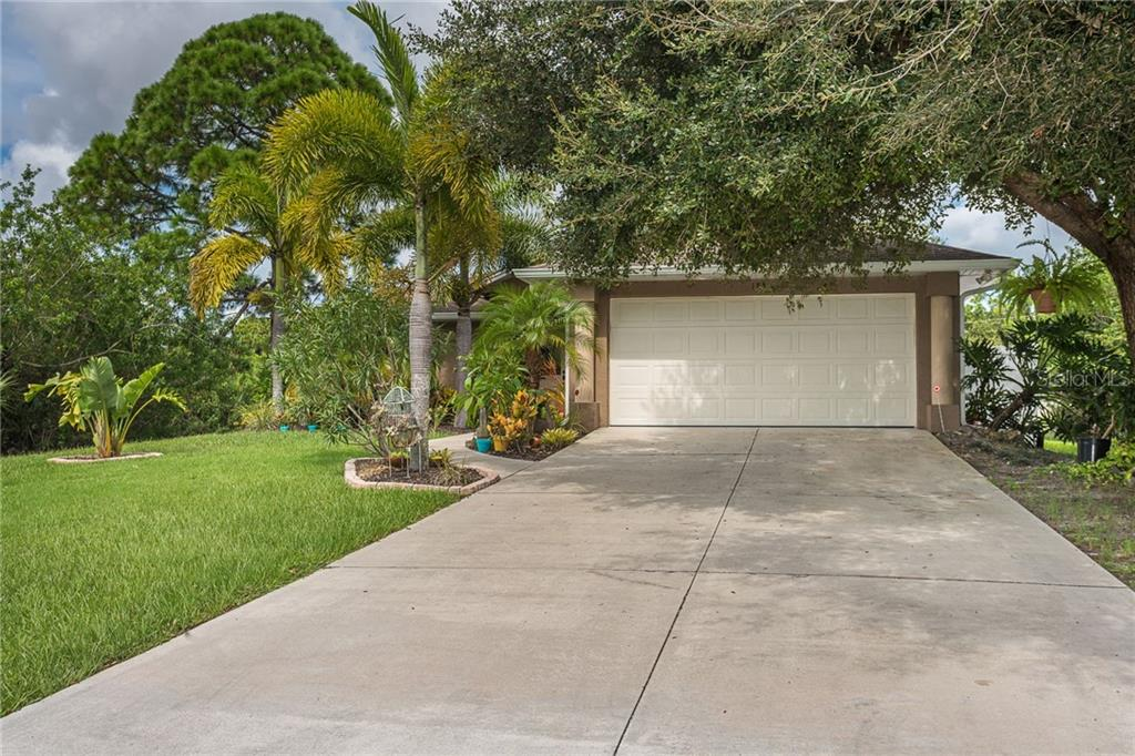 Mature landscaping welcomes you to this tropical paradise! - Single Family Home for sale at 185 Apollo Dr, Rotonda West, FL 33947 - MLS Number is D6113690