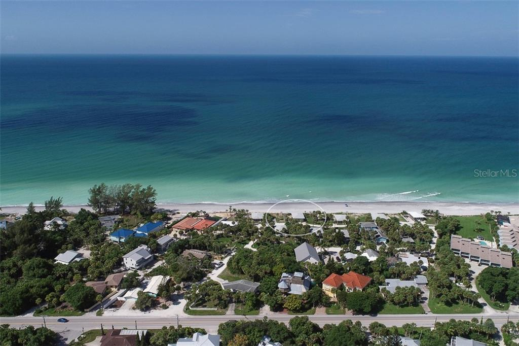 Aerial view of the Beach and the Beautiful aqua/blue colors of the Gulf - Single Family Home for sale at 4074 N Beach Rd #Ctg4, Englewood, FL 34223 - MLS Number is D6114111