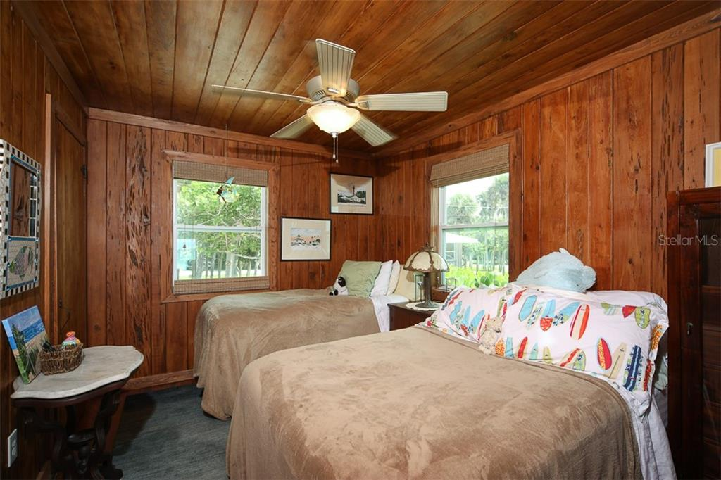 Second/Guest Bedroom with Ceiling Fan; Walk-In Closet; Storage Closet - Single Family Home for sale at 4074 N Beach Rd #Ctg4, Englewood, FL 34223 - MLS Number is D6114111