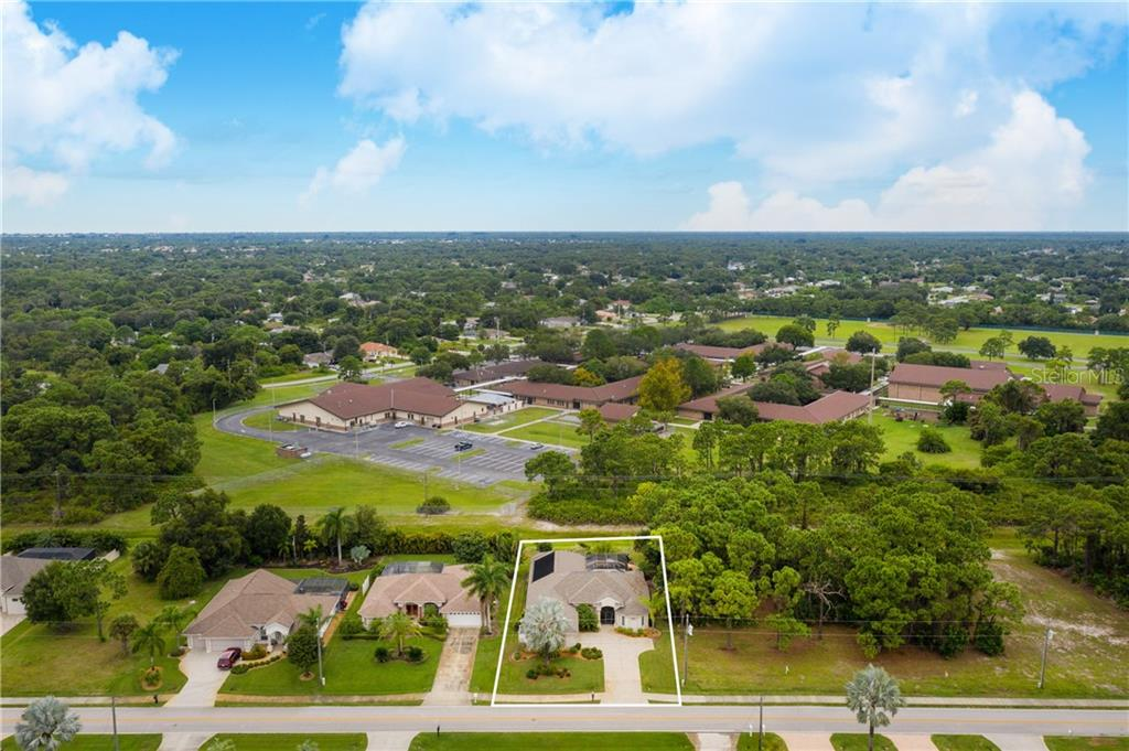 Aerial view of property. - Single Family Home for sale at 439 Boundary Blvd, Rotonda West, FL 33947 - MLS Number is D6114162