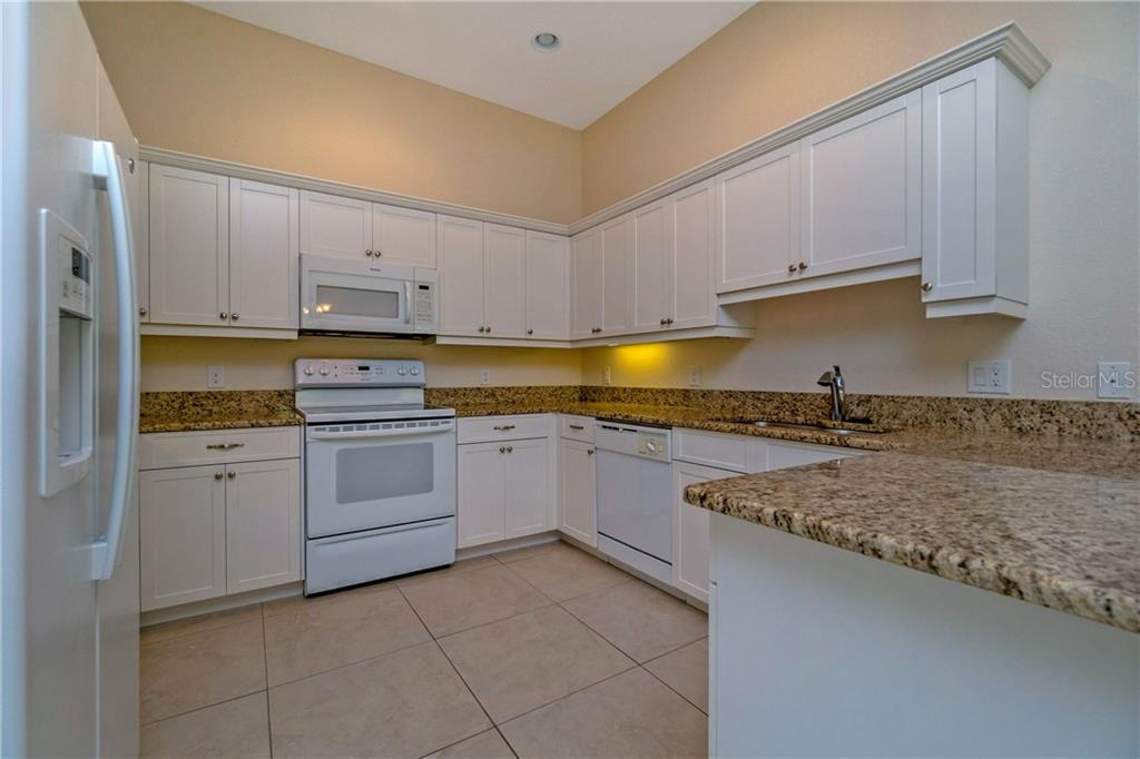 THE KITCHEN INCLUDES REFRIGERATOR, RANGE, EYE LEVEL MICROWAVE, DISHWASHER & DISPOSAL. - Single Family Home for sale at 112 Boxwood Ln, Rotonda West, FL 33947 - MLS Number is D6114179