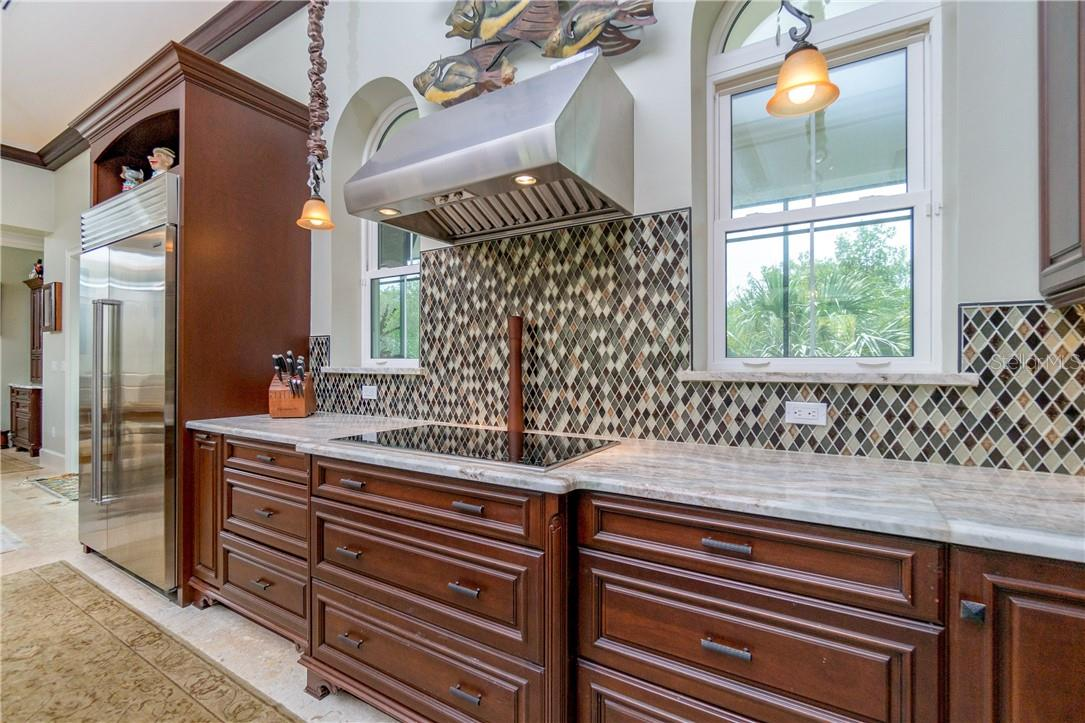 Deep farm sink, granite counters & trash compactor - Single Family Home for sale at 10161 Eagle Preserve Dr, Englewood, FL 34224 - MLS Number is D6114216