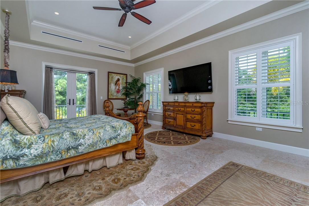 Tray ceilings, crown molding, bedside chandeliers & private seating area. - Single Family Home for sale at 10161 Eagle Preserve Dr, Englewood, FL 34224 - MLS Number is D6114216