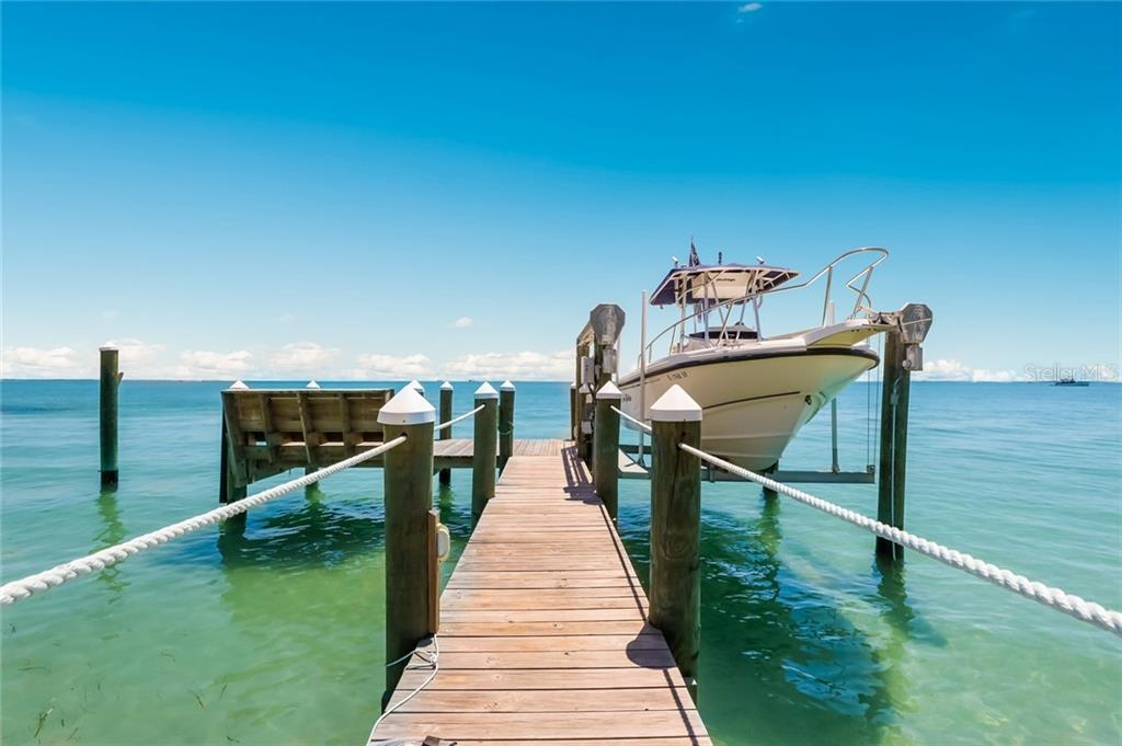 Private dock constructed in 2018 with lift, water & electric - Single Family Home for sale at 561 Buttonwood Bay Dr, Boca Grande, FL 33921 - MLS Number is D6114322
