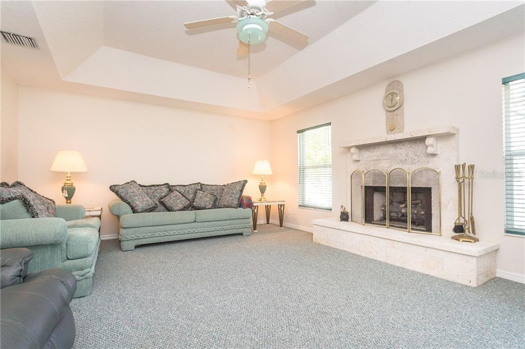 The large family room has a beautiful gas burning fireplace - Single Family Home for sale at 1720 Larson St, Englewood, FL 34223 - MLS Number is D6114414