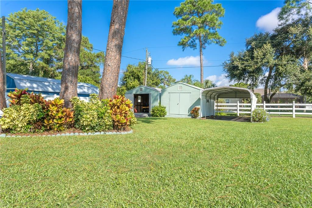 2 sheds and a carport in the back corner of the property. - Single Family Home for sale at 1720 Larson St, Englewood, FL 34223 - MLS Number is D6114414