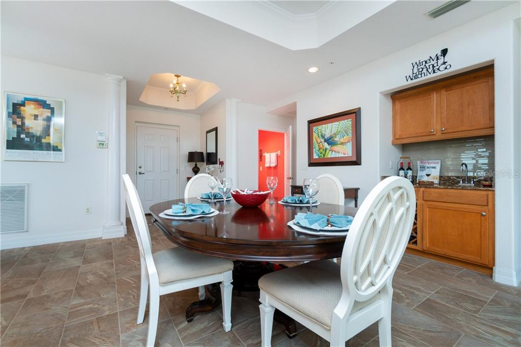 Dining Table with Half Bath in the Background - Condo for sale at 2225 N Beach Rd #401, Englewood, FL 34223 - MLS Number is D6114646
