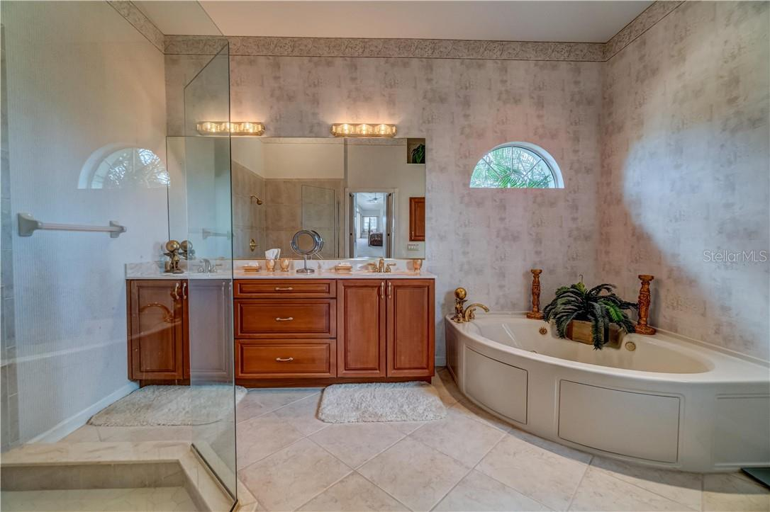 Yes, the master bath. No expense was spared in this room, with the super clean looking frameless glass shower to the jetted soak tub. - Single Family Home for sale at 12307 S Access Rd, Port Charlotte, FL 33981 - MLS Number is D6117140
