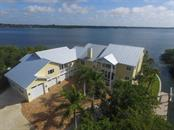 Front of home - Single Family Home for sale at 7295 Manasota Key Rd, Englewood, FL 34223 - MLS Number is D5911936