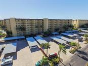 Front - Condo for sale at 5760 Midnight Pass Rd #702, Sarasota, FL 34242 - MLS Number is D5916943