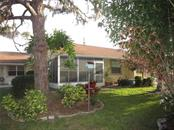 Screened Lanai is the perfect place to bird watch. - Condo for sale at 6796 Gasparilla Pines Blvd #14, Englewood, FL 34224 - MLS Number is D5919892