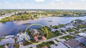 Since location is everything, let's start there.  The home sits off Gottfried Creek with no bridges to the bay, which is just out of sight to the right in this photo. - Single Family Home for sale at 1439 Deer Creek Dr, Englewood, FL 34223 - MLS Number is D5921060
