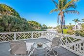 Main level deck overlooking the lake - Single Family Home for sale at 186 Carrick Bend Ln, Boca Grande, FL 33921 - MLS Number is D5923688