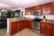 Kitchen Opens to Dining Area - Condo for sale at 50 Meredith Dr #8, Englewood, FL 34223 - MLS Number is D6103644