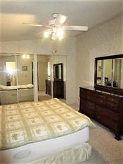 Master bedroom has an ensuite bath. - Manufactured Home for sale at 1800 Englewood Rd #95, Englewood, FL 34223 - MLS Number is D6103776