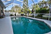 Pool, Screened enclosure overlooking backyard. - Single Family Home for sale at 8 Medalist Cir, Rotonda West, FL 33947 - MLS Number is D6104474