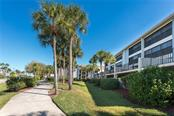 Walk through the park-like setting of the grounds at Sandpiper Key, and you will feel at home! - Condo for sale at 1551 Beach Rd #412, Englewood, FL 34223 - MLS Number is D6110828