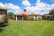 REAR VIEW OF HOME - Single Family Home for sale at 3583 Royal Palm Dr, North Port, FL 34288 - MLS Number is D6111716