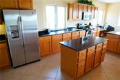Another view shows the drawers and cabinet in island along with the abundance of counter space. - Condo for sale at 2245 N Beach Rd #304, Englewood, FL 34223 - MLS Number is D6112346