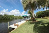 60 Ft. Concrete Dock and 14,000 lb Covered Boat Lift - Single Family Home for sale at 9300 Hialeah Ter, Port Charlotte, FL 33981 - MLS Number is D6113597