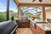 OUTDOOR KITCHEN - Single Family Home for sale at 1944 Coconut Palm Cir, North Port, FL 34288 - MLS Number is D6114523