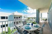 Balcony Off Living Room - Condo for sale at 2225 N Beach Rd #401, Englewood, FL 34223 - MLS Number is D6114646