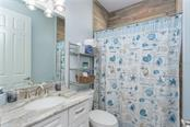 Bathroom 2 offers a 3 piece set-up with a tub - Single Family Home for sale at 145 Leland St Se, Port Charlotte, FL 33952 - MLS Number is D6117438