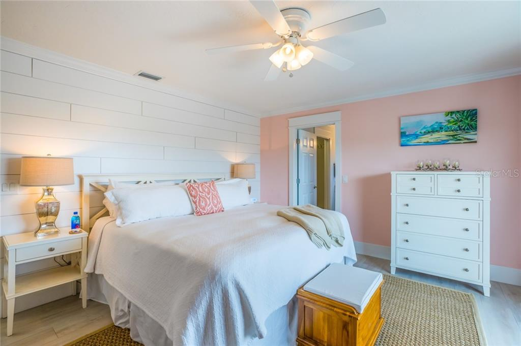 The third master suite also offers a private bathroom and driftwood style porcelain floors - Single Family Home for sale at 511 Loquat Dr, Anna Maria, FL 34216 - MLS Number is T3196169