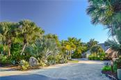 View of property from Casey Key Road - Single Family Home for sale at 140 N Casey Key Rd, Osprey, FL 34229 - MLS Number is T3228618