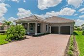Single Family Home for sale at 4847 Royal Dornoch Cir, Bradenton, FL 34211 - MLS Number is O5768432