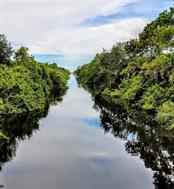 Looking South on Como waterway into Myakka & Peace Rivers to Charlotte Harbor - Vacant Land for sale at 2298 Como St, Port Charlotte, FL 33948 - MLS Number is U8017900