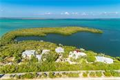 Single Family Home for sale at 28 Grouper Hole Dr, Boca Grande, FL 33921 - MLS Number is U8083181