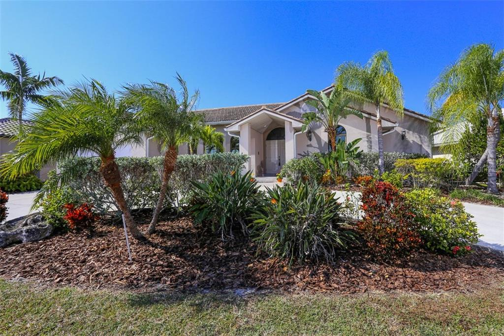 Circular driveway enhances the entrance to this lovely home - Single Family Home for sale at 3419 Sandpiper Dr, Punta Gorda, FL 33950 - MLS Number is C7232529