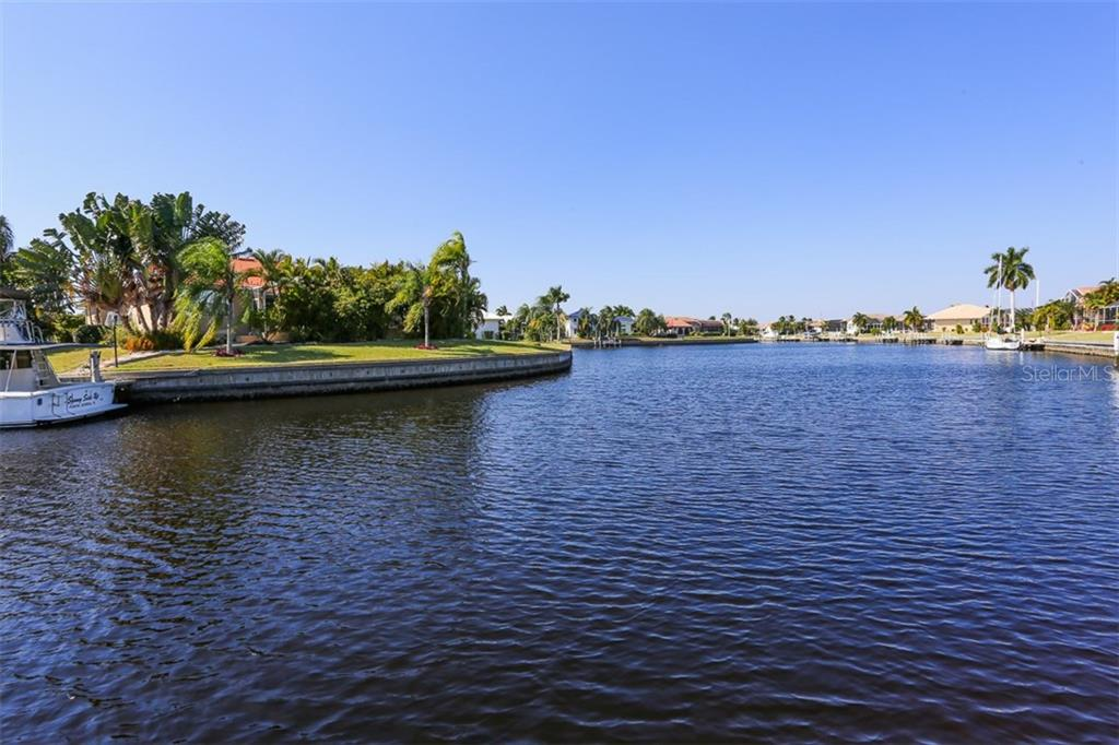 View of the wide intersecting canal views - Single Family Home for sale at 3419 Sandpiper Dr, Punta Gorda, FL 33950 - MLS Number is C7232529