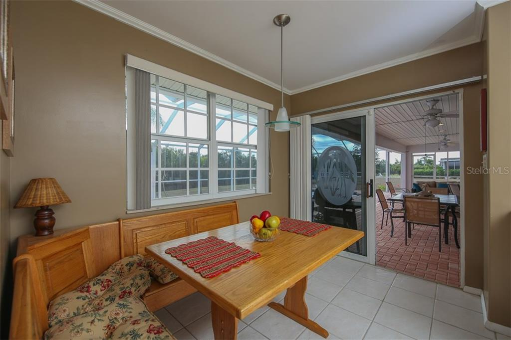 Eat-in Kitchen flows to the Lanai for casual dining options - Single Family Home for sale at 2332 Mauritania Rd, Punta Gorda, FL 33983 - MLS Number is C7234250