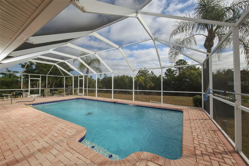Newly refinished large heated pool with paver deck - Single Family Home for sale at 2332 Mauritania Rd, Punta Gorda, FL 33983 - MLS Number is C7234250