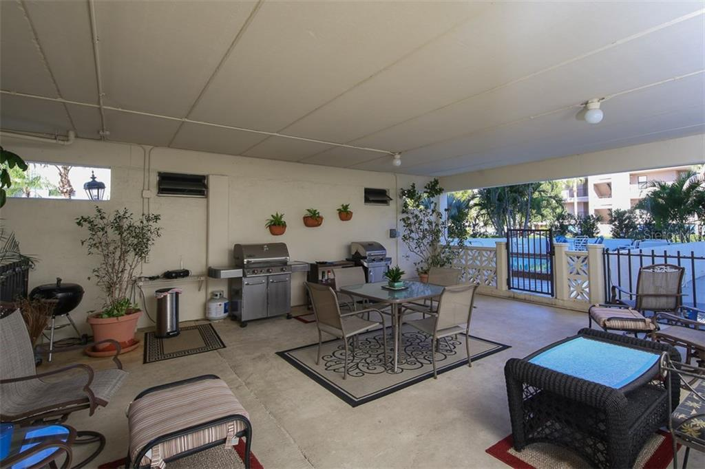 Covered community sitting area with gas grills - Condo for sale at 1765 Jamaica Way #302, Punta Gorda, FL 33950 - MLS Number is C7234643