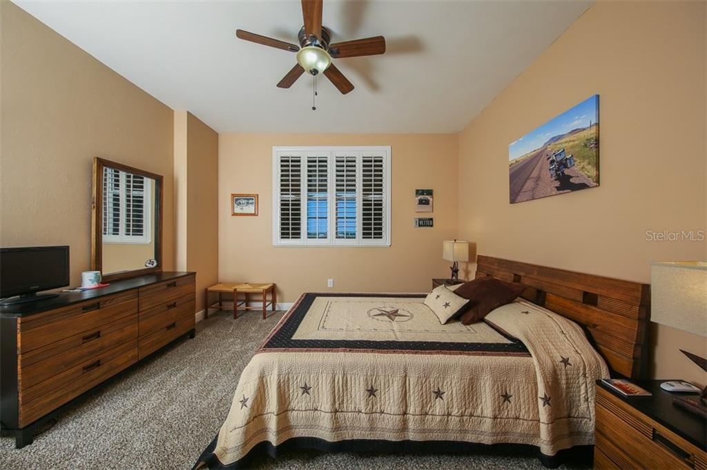 2nd Bedroom is located at the front of the residence and it too features a walk-in closet, new carpet and crisp plantation shutters that accentuates the paint tone. - Condo for sale at 3313 Sunset Key Cir #402, Punta Gorda, FL 33955 - MLS Number is C7236886