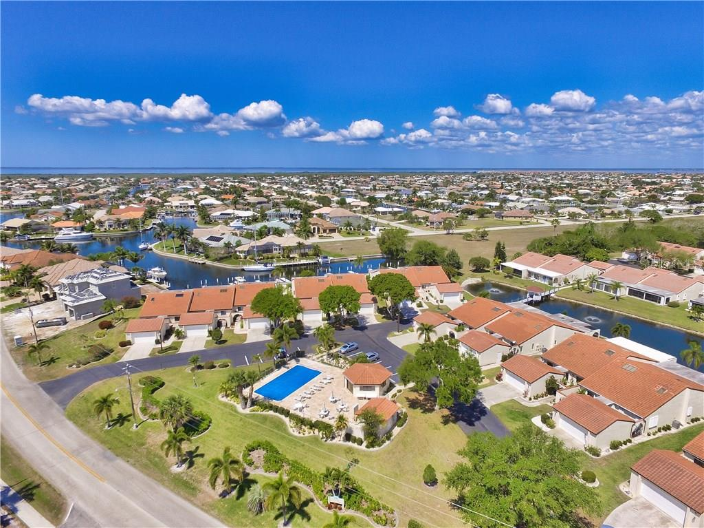 Only 7 villas have the saltwater canal frontage in this community.  #24 is right across from the pool and guest parking spaces.  This villa has a western facing lanai for incredible sunset views! - Villa for sale at 1890 Deborah Dr #24, Punta Gorda, FL 33950 - MLS Number is C7237753