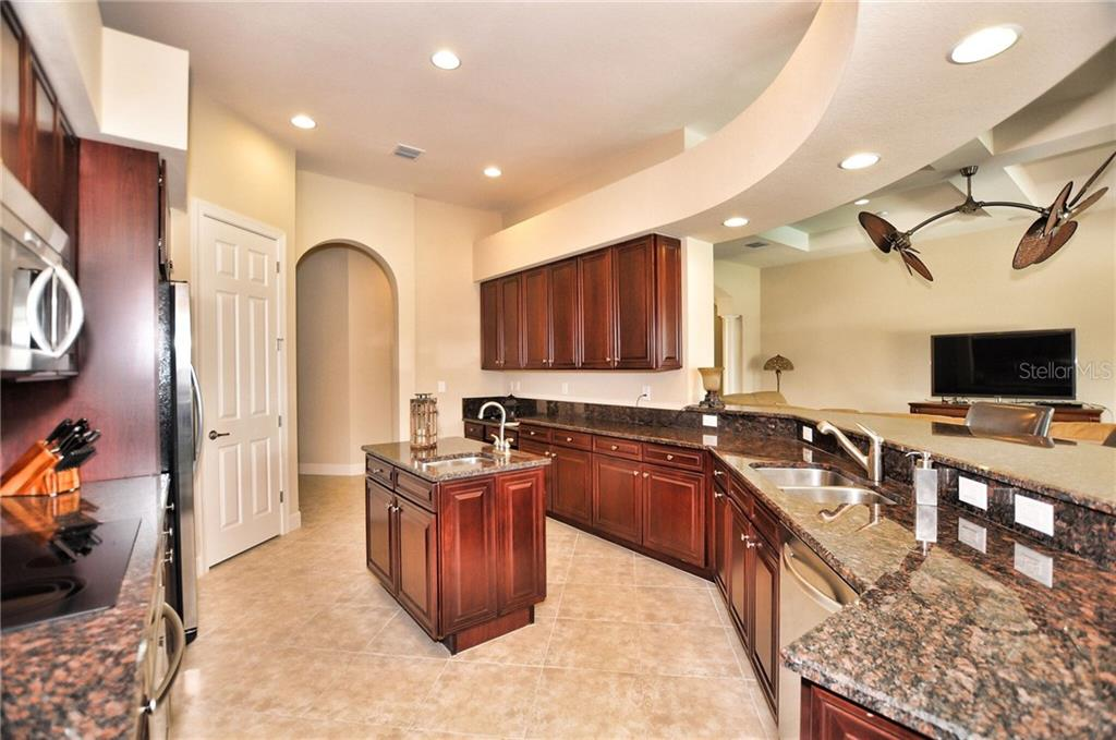 A pleasure to cook in your gourmet kitchen and surround yourself with this beautiful selection of solid-wood cabinetry, complimented with tasteful granite countertops, with a pantry for extra storage, and an additional stainless steel sink, in your fabulous island. - Single Family Home for sale at 2839 Mill Creek Rd, Port Charlotte, FL 33953 - MLS Number is C7238545