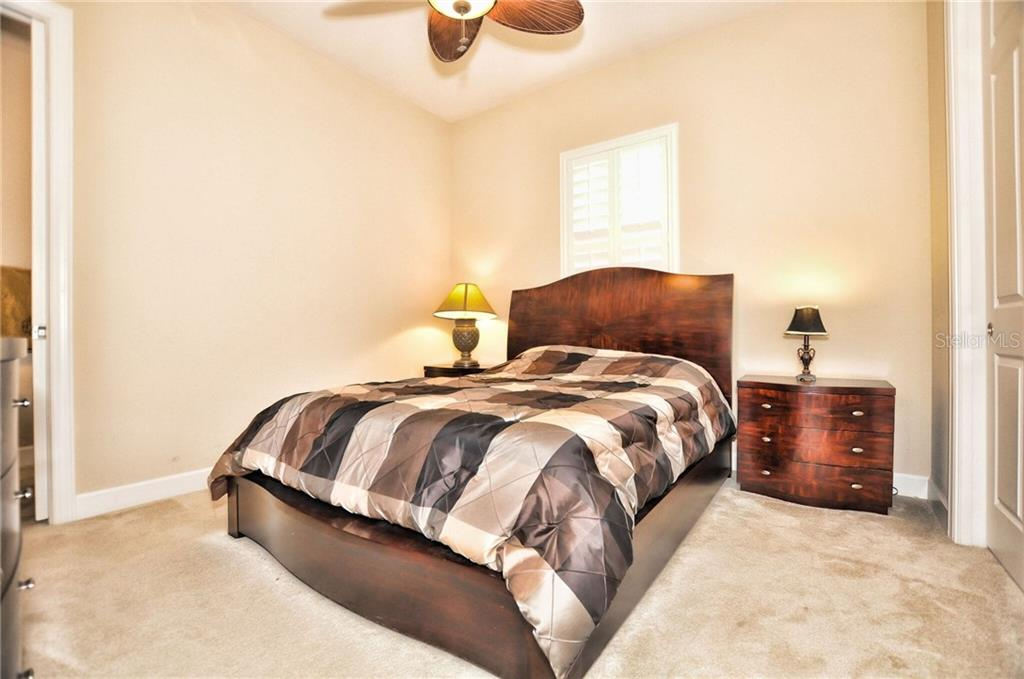 Your spacious guest ensuite with convenient pool bath accessibility. - Single Family Home for sale at 2839 Mill Creek Rd, Port Charlotte, FL 33953 - MLS Number is C7238545