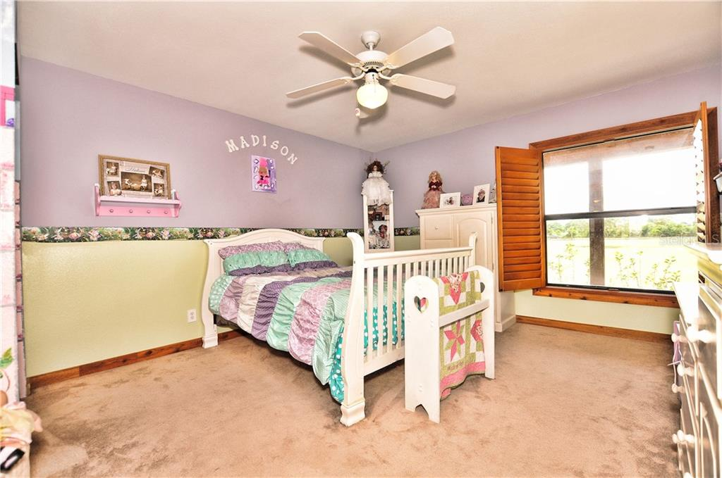 Guest Room #1 with adjoining bathroom to Guest #2 - Single Family Home for sale at 30720 Washington Loop Rd, Punta Gorda, FL 33982 - MLS Number is C7239690