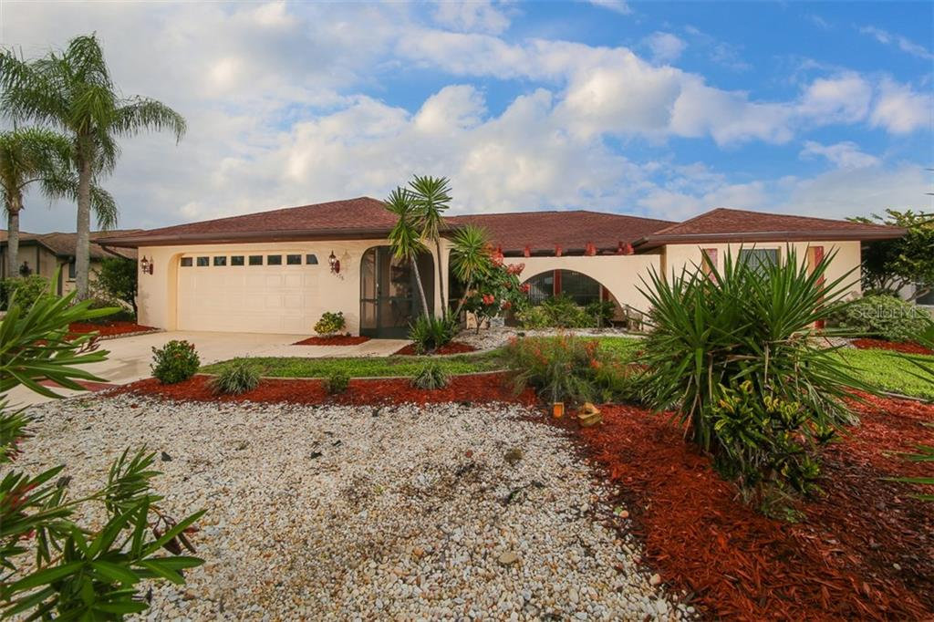 Great curb appeal - extra long driveway and additional parking in front - Single Family Home for sale at 26178 Rampart Blvd, Punta Gorda, FL 33983 - MLS Number is C7240559