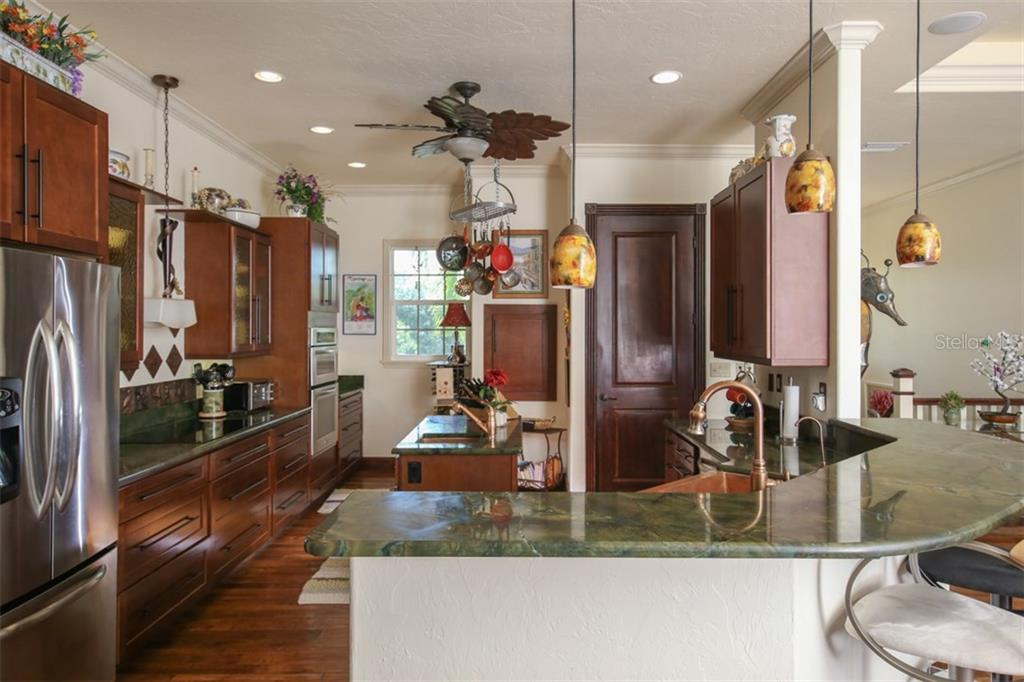 State-of-the-art gourmet kitchen with top of the line stainless steel appliances - Single Family Home for sale at 17296 Foremost Ln, Port Charlotte, FL 33948 - MLS Number is C7240998
